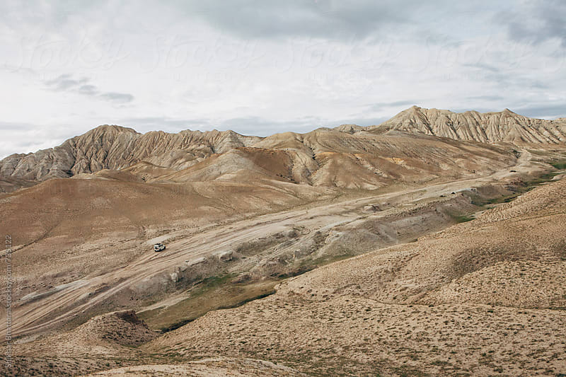 Off-roading in the barren landscapes of Upper Mustang, Nepal. by Shikhar Bhattarai for Stocksy United