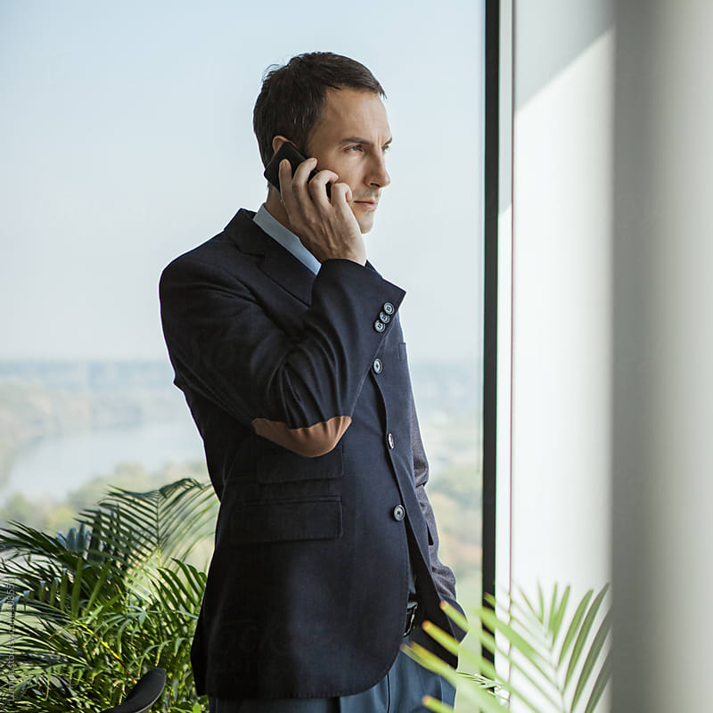 Businessman Telephoning at His Office by Lumina for Stocksy United