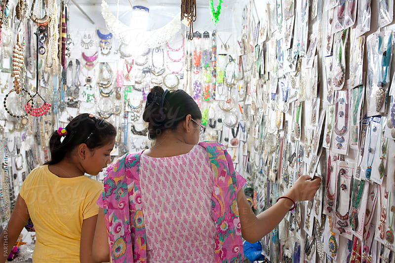 Mother and daughter selecting ear rings in a shop by PARTHA PAL for Stocksy United