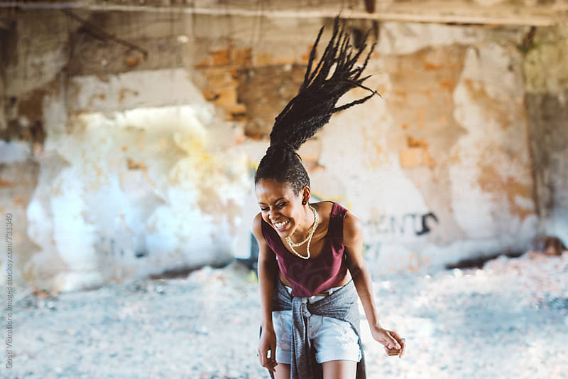 Woman with Dreadlocks dancing indoors by Good Vibrations Images for Stocksy United