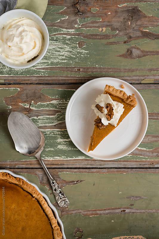 pumpkin pie with caramelized walnuts by Gillian Vann for Stocksy United