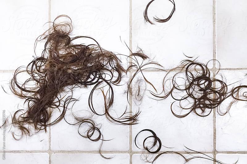 hair cut, hair cuttings on tiled floor by Gillian Vann for Stocksy United