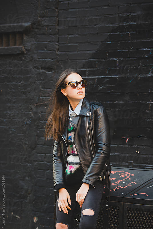 Young woman hanging out in the city by Lauren Naefe for Stocksy United