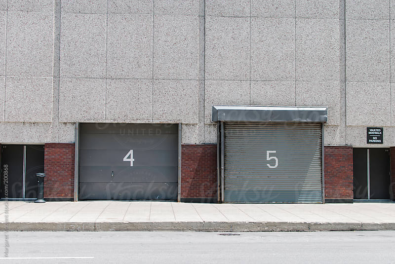 garage doors #4 and 5 by Margaret Vincent for Stocksy United