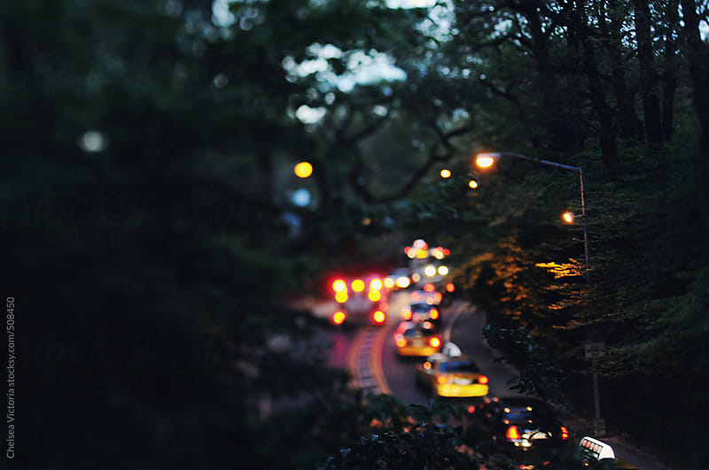 Traffic at night leaving central park in Manhattan by Chelsea Victoria for Stocksy United