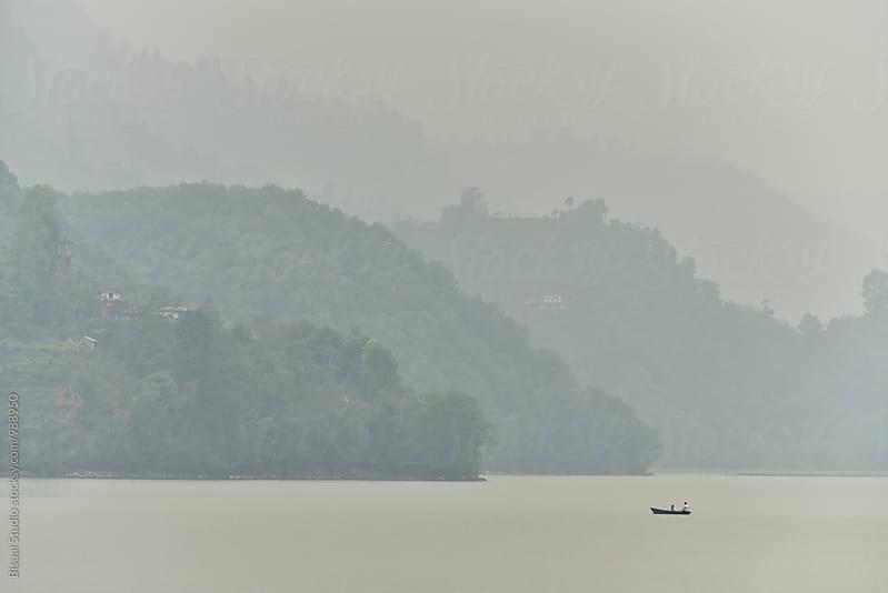 A lone boat on Phewa Lake in Phokara by Bisual Studio for Stocksy United