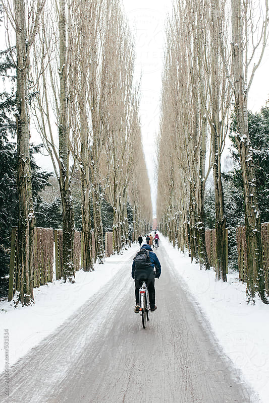 Cyclists in the Snow by Zocky for Stocksy United