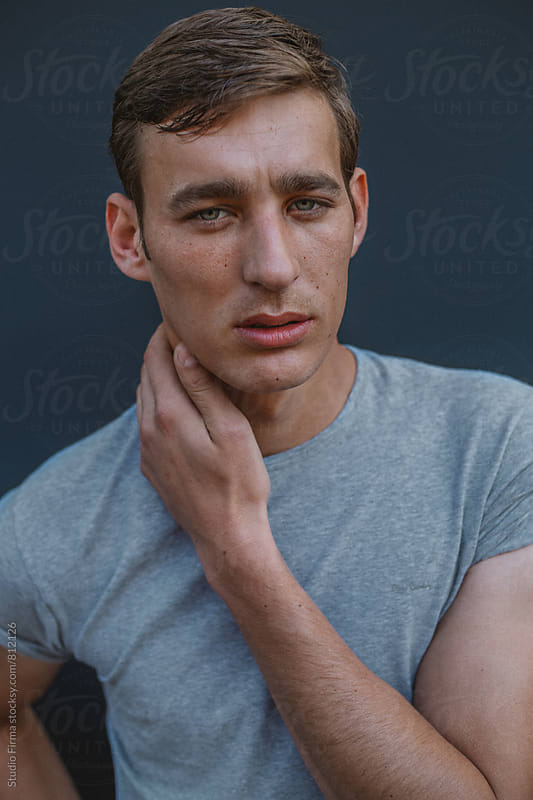 Portrait of a young man by Studio Firma for Stocksy United
