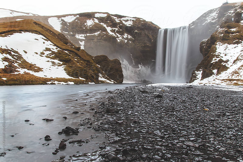 Skógafoss in the rain by Kimberly Kendall for Stocksy United