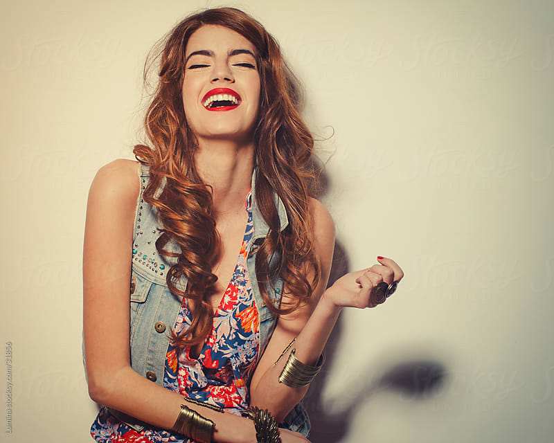 Fashion Model Laughing by Lumina for Stocksy United