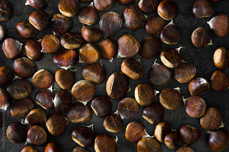 Raw chestnuts ready to be cooked by Pixel Stories for Stocksy United
