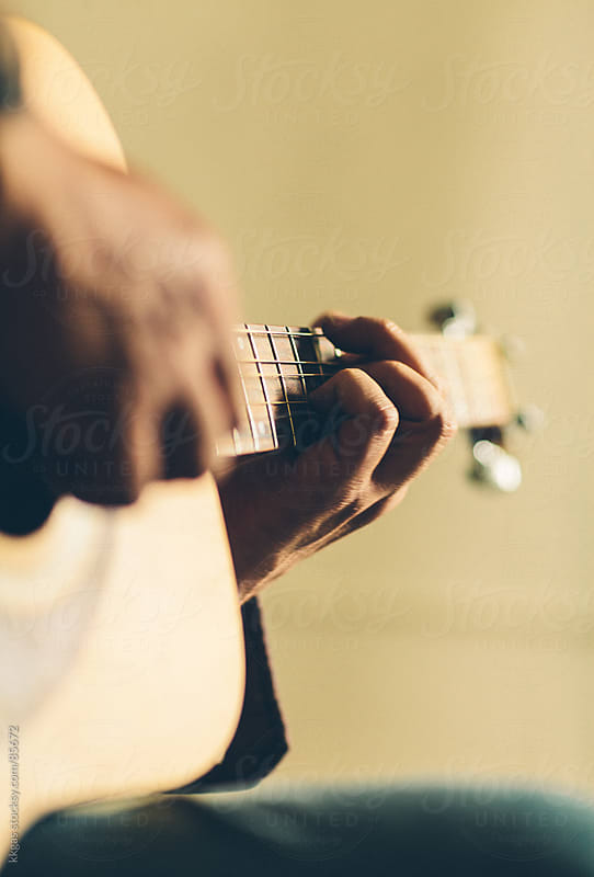Close up of hands playing an acoustic guitar by kkgas for Stocksy United