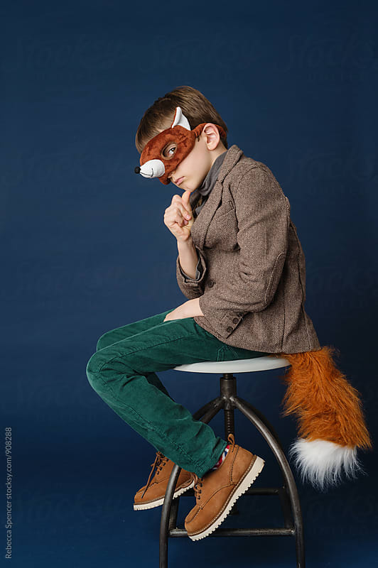 Suave young boy dressed as Mr Fox  by Rebecca Spencer for Stocksy United