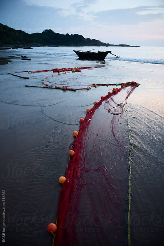 Boat and fishing net  by RG&B Images for Stocksy United