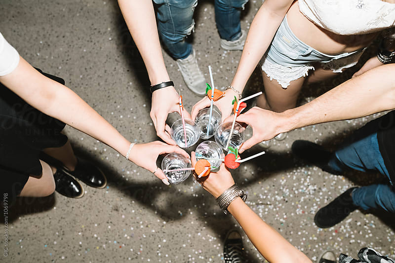 Friends toasting in a night party by Simone Becchetti for Stocksy United