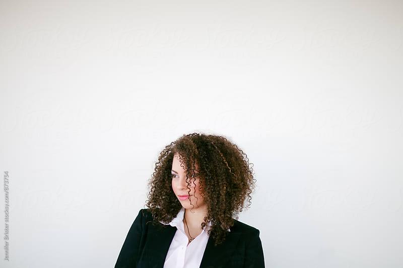 Beautiful woman looking sideways by Jennifer Brister for Stocksy United