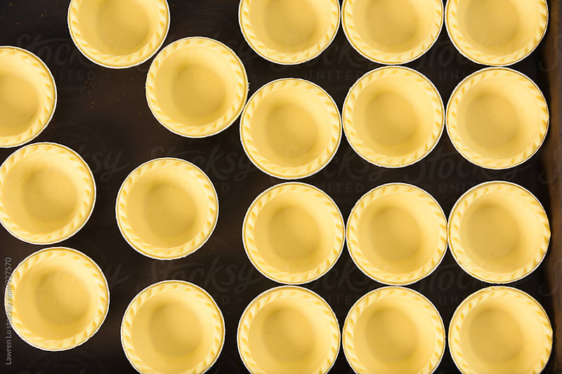 Tasty several baked tarts for caramel custard by Lawren Lu for Stocksy United