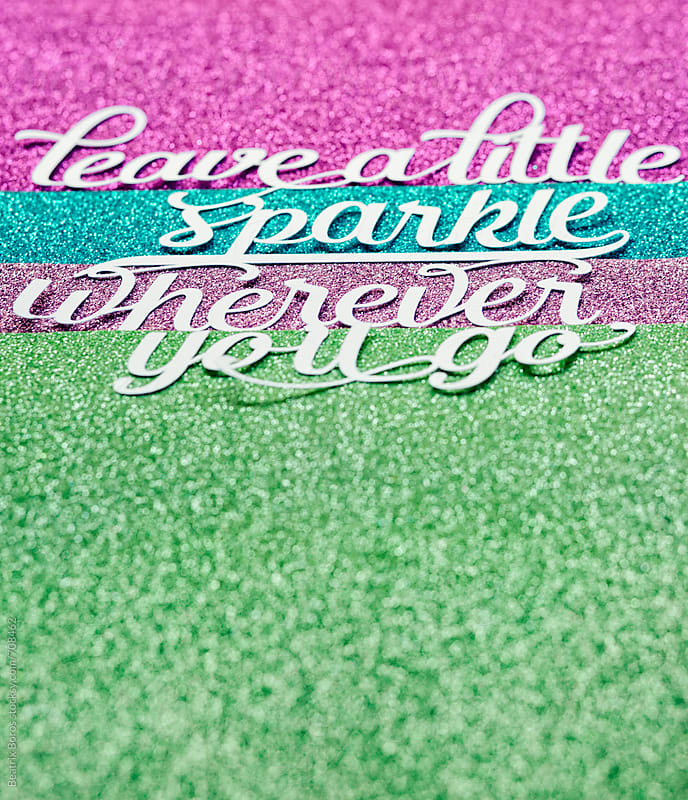 Wise message cut out of paper on shiny glitter background by Beatrix Boros for Stocksy United