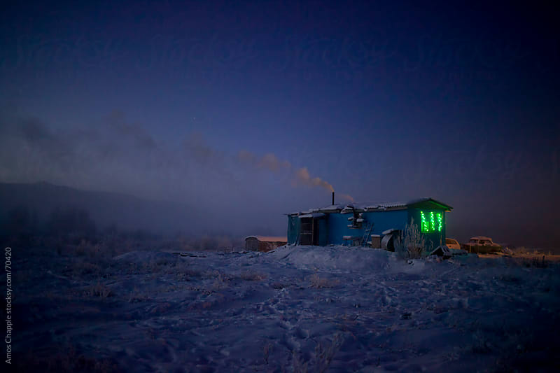 A lonely truck-stop near the world's coldest village.  by Amos Chapple for Stocksy United