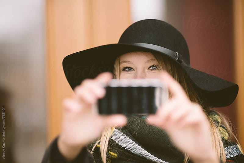 happy woman takes a selfie with the cell phone,selective focus  by Alexey Kuzma for Stocksy United