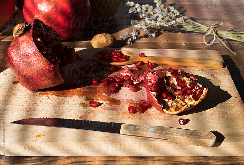 Cut Pomegranate on the Table by Mosuno for Stocksy United