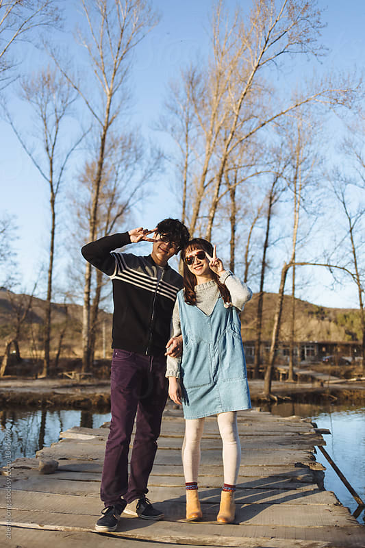 young couple Outdoors by zheng long for Stocksy United