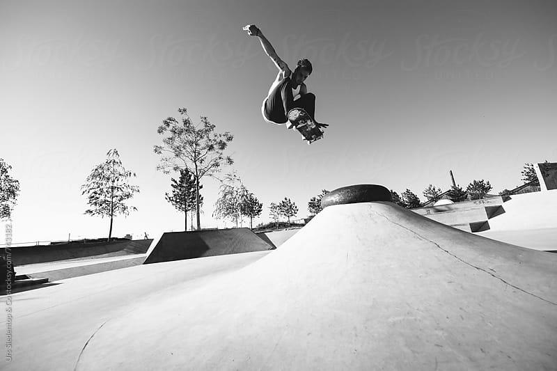 Skateboard ollie transfer in Skatepark by Urs Siedentop & Co for Stocksy United