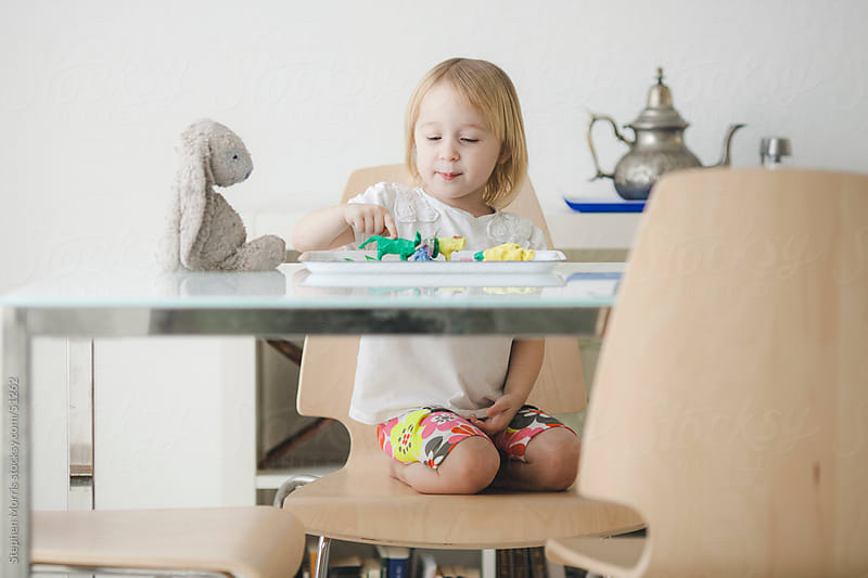 Little Girl Playing with Play Dough by Stephen Morris for Stocksy United