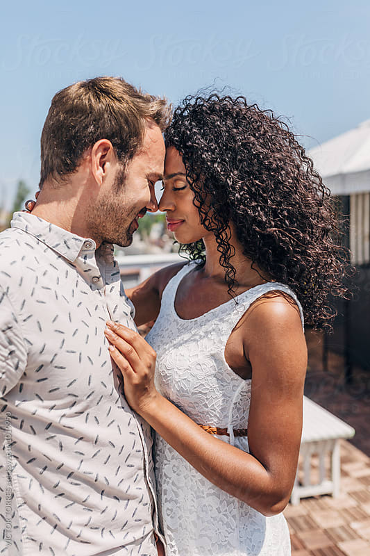 Multi-Ethnic Couple Having Fun in a Summer Day by VICTOR TORRES for Stocksy United