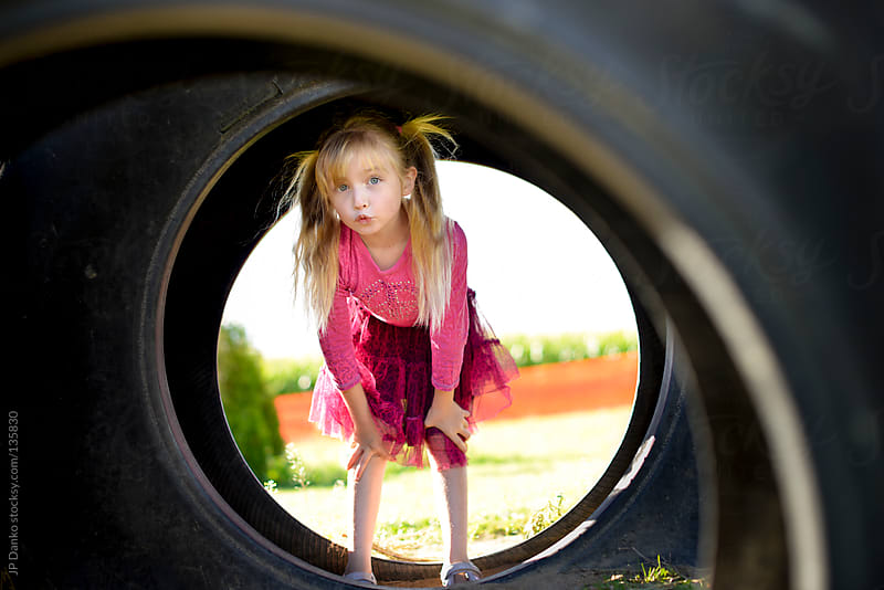 Funny Little Girl Playing at Park Outdoors by JP Danko for Stocksy United