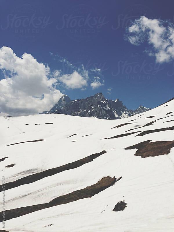 Alpine peak by Neil Warburton for Stocksy United