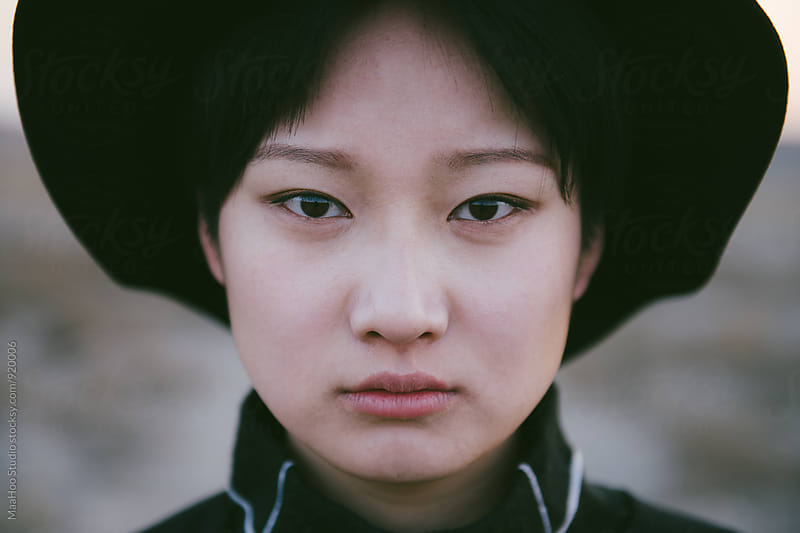 Portrait of a young chinese woman by Maa Hoo for Stocksy United