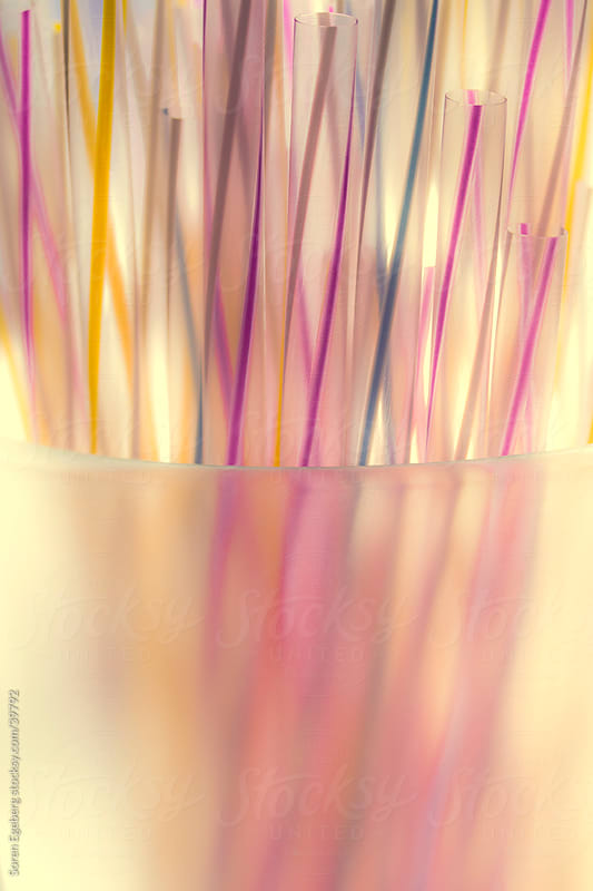 Multi colored drinking straws in close-up in glass by Soren Egeberg for Stocksy United