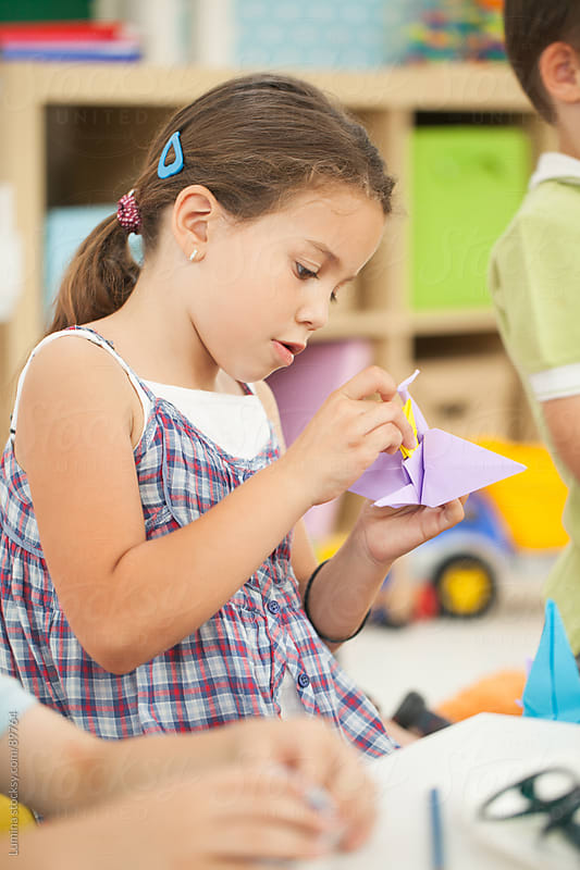 Girl Making Origami Birds by Lumina for Stocksy United