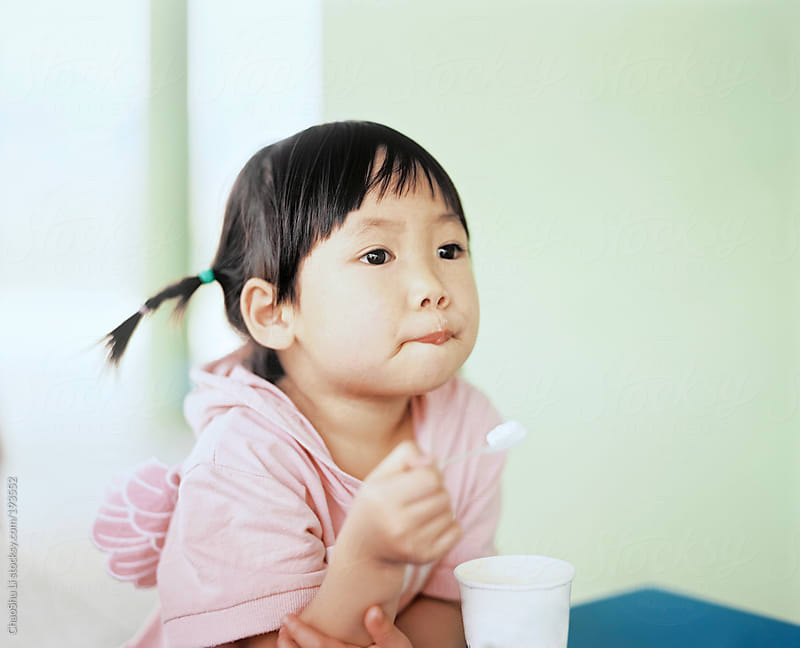 Asian little girl at home, by 120 film by ChaoShu Li for Stocksy United