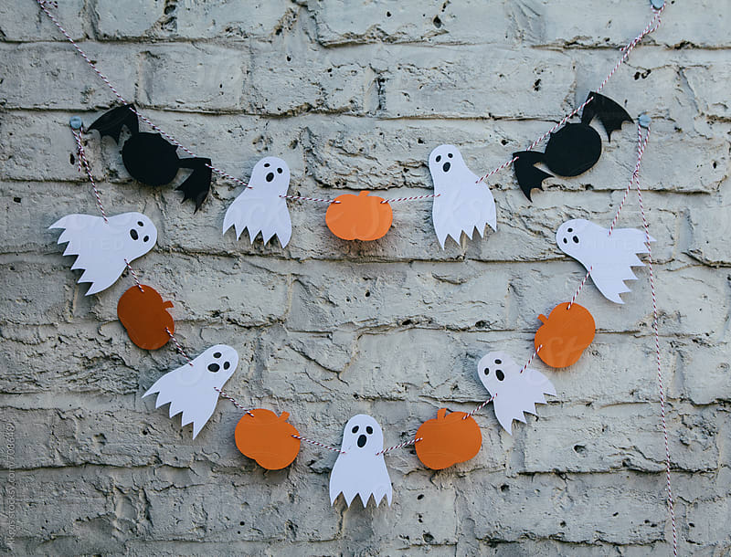 Halloween decoration against a grunge brick wall. by kkgas for Stocksy United