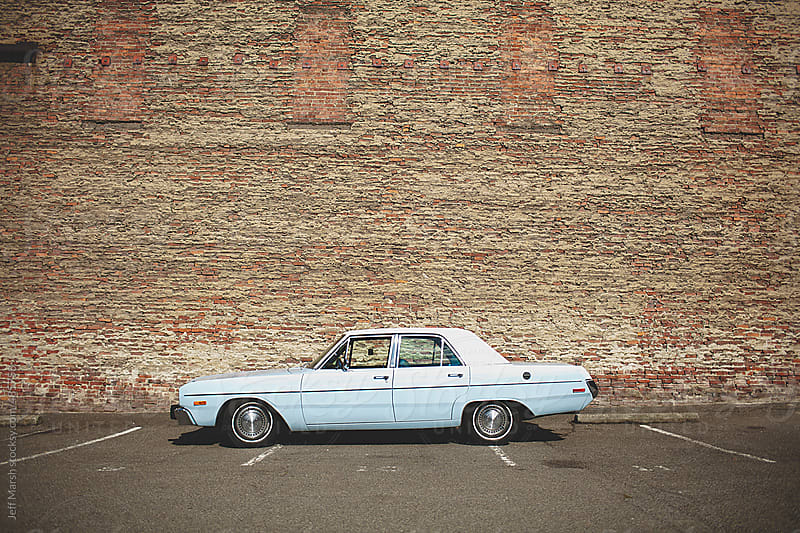 A car in a parking lot by Jeff Marsh for Stocksy United