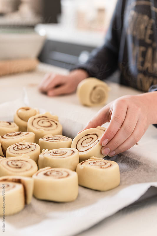 cinnamon buns rolled and ready for the oven by Gillian Vann for Stocksy United