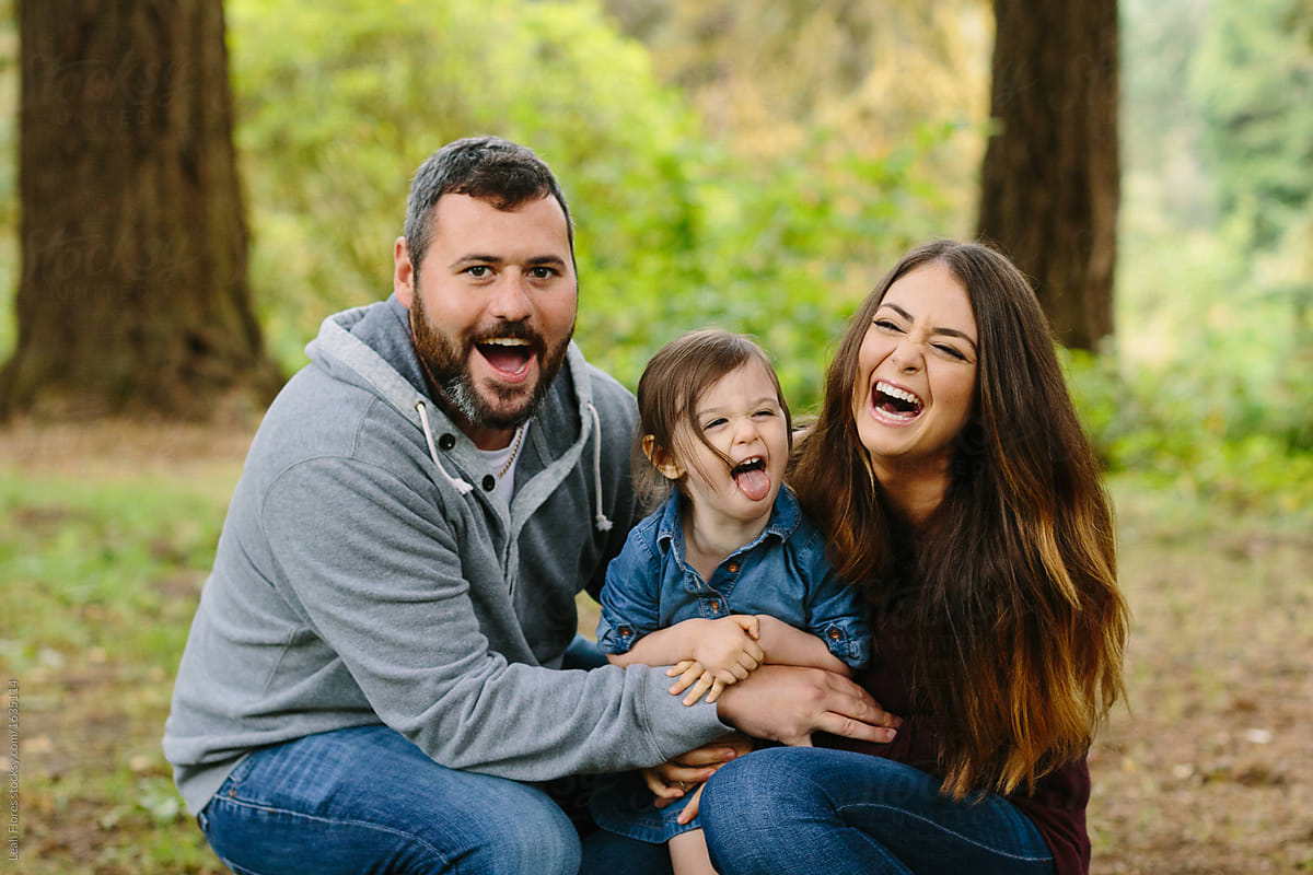 Portrait of cute family laughing loudly by leah flores for stocksy united