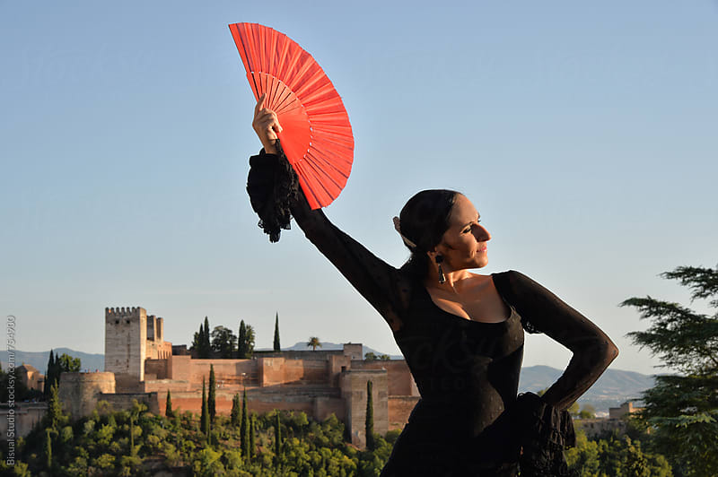 Professional flamenco dancing in front of Alhambra, Granada by Bisual Studio for Stocksy United