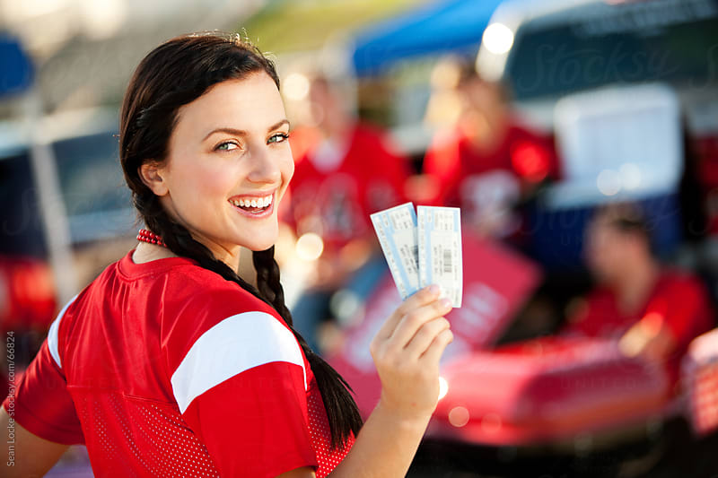 Tailgating: Girl Excited for Football Game with Tickets by Sean Locke for Stocksy United