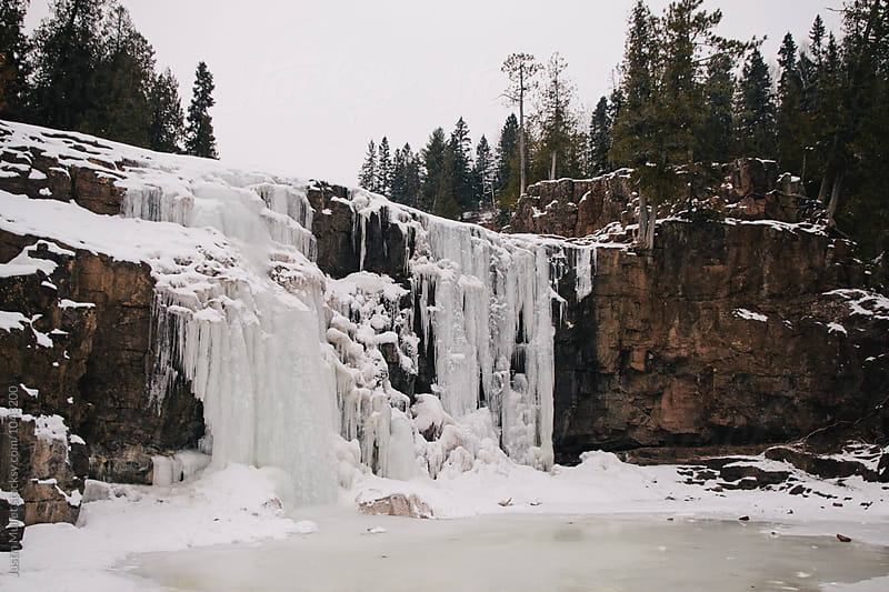 Frozen waterfall in Minnesota by Justin Mullet for Stocksy United
