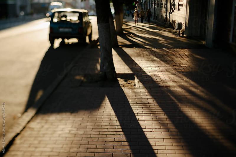 street with warm light by Alexey Kuzma for Stocksy United