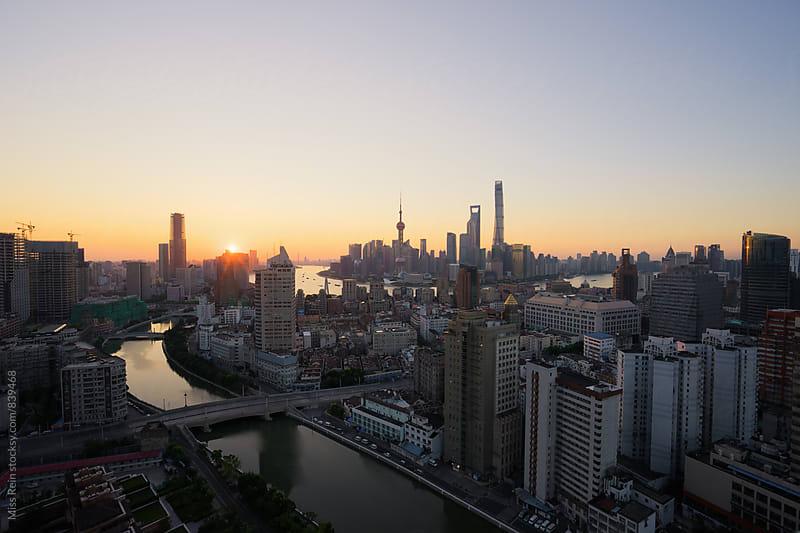 shanghai sunrise by Miss Rein for Stocksy United