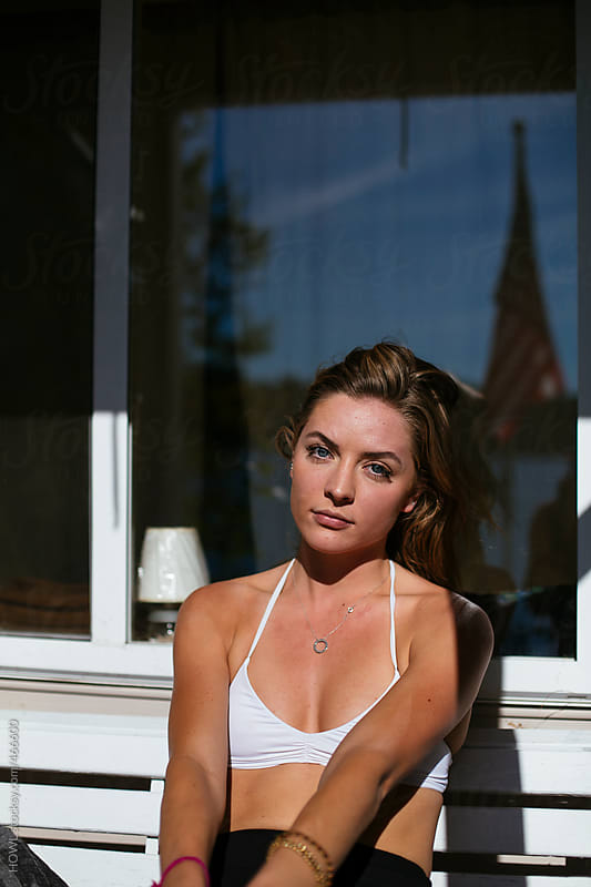 Beautiful blonde basks in the afternoon sunlight  by HOWL for Stocksy United