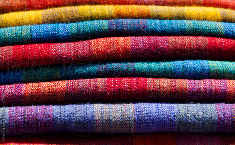 Abstract shot of colourful blankets folded on top of each other. by Mike Marlowe for Stocksy United
