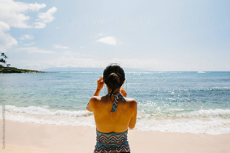 Back view of woman looking out into the ocean by Curtis Kim for Stocksy United