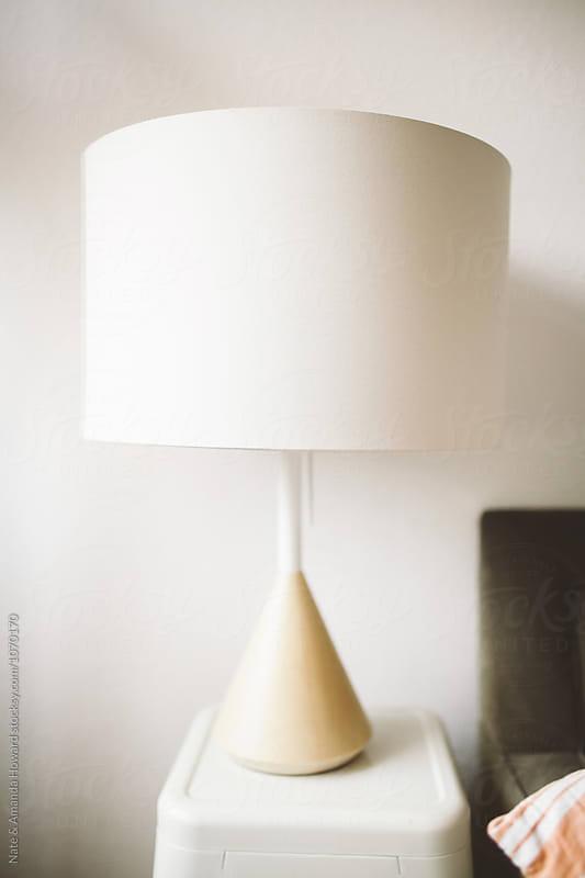 white lamp by Nate & Amanda Howard for Stocksy United