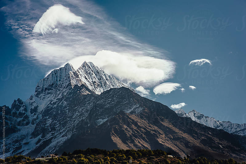 Himalayan landscape of Thamserku mountain and dramatic cloudscape with copy space in wide format. by Soren Egeberg for Stocksy United
