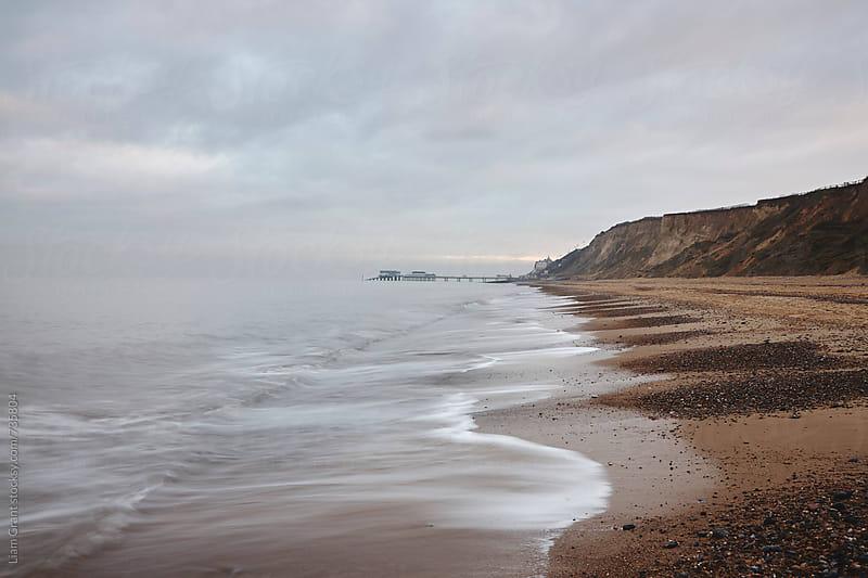 Cromer Pier and slipway, from East Runton beach. Norfolk, UK. by Liam Grant for Stocksy United